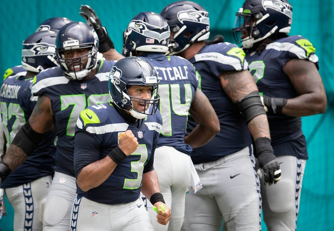 Seahawks quarterback Russell Wilson celebrates a first-quarter touchdown Sunday against the Dolphins.