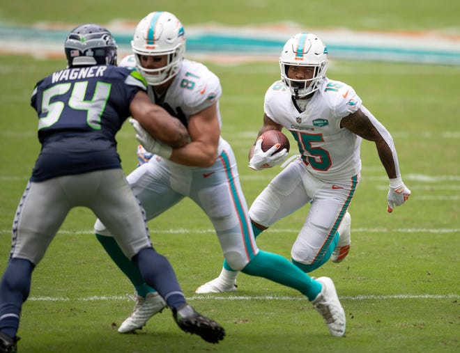 Dolphins receiver Lynn Bowden gains 5 yards on a run out of the Wildcat against the Seahawks.