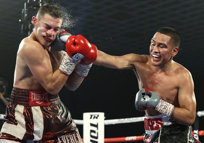 Stockton fighter Gabriel Flores Jr. (right) lands a stiff right hand to the face of veteran Ryan Kielczweski during their 10-round lightweight fight on Saturday night in Las Vegas. The undefeated Flores won by unanimous decision.