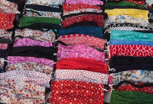 Some of the 200 colorful face masks given to the IME Social Welfare Group.