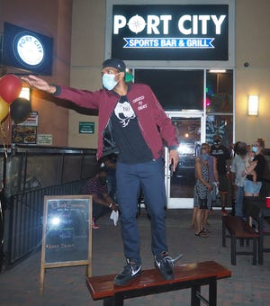 Brandon Leake gestures as he recites one of his poems during an impromptu performance at Port City Bar & Grill in downtown Stockton in early October. [CALIXTRO ROMIAS/THE STOCKTON RECORD]