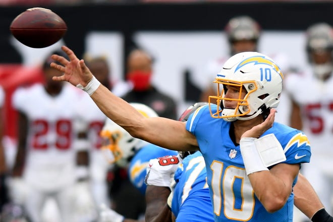 Los Angeles Chargers quarterback Justin Herbert (10) fires a pass against the Tampa Bay Buccaneers on Sunday in Tampa, Fla. [AP Photo/Jason Behnken]