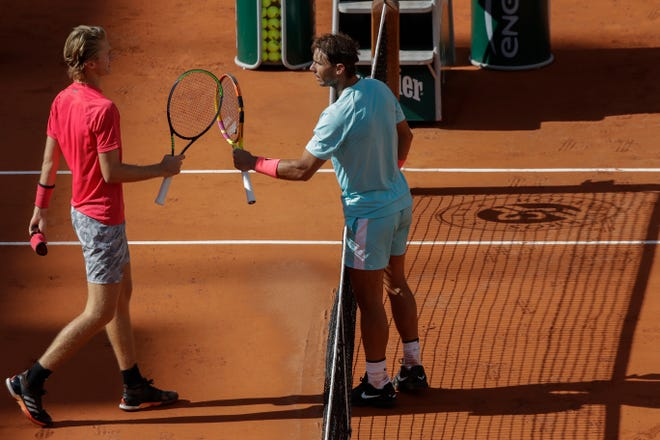 Sebastian Korda of Bradenton congratulates Rafael Nadal, right, with his win in the fourth round match of the French Open tennis tournament at the Roland Garros stadium in Paris on Sunday.