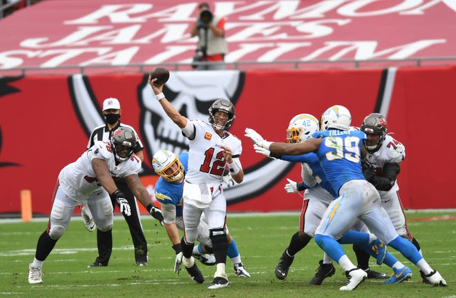 Tampa Bay Buccaneers quarterback Tom Brady (12) throws a pass against the Los Angeles Chargers during the second half of an NFL football game Sunday, Oct. 4, 2020, in Tampa, Fla. (AP Photo/Jason Behnken)