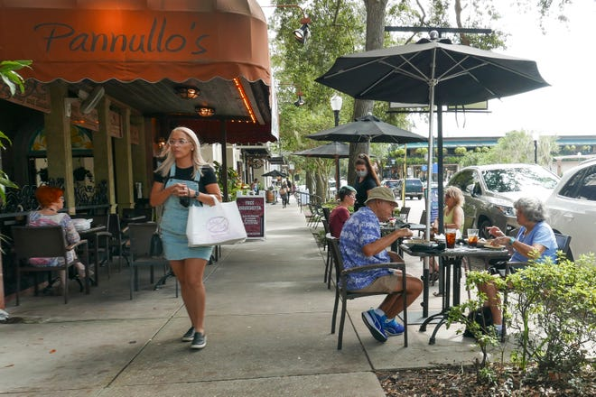 Patrons dine at a restaurant on Friday in Winter Park. Florida Gov. Ron DeSantis says contact tracing has not shown restaurants to be a substantial source of COVID-19 spread.