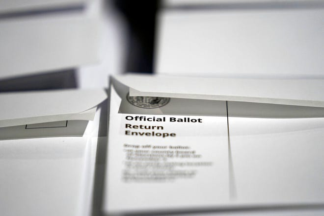 FILE - In this Thursday, Sept. 3, 2020, file photo, stacks of ballot envelopes waiting to be mailed are seen at the Wake County Board of Elections in Raleigh, N.C. (AP Photo/Gerry Broome, File)