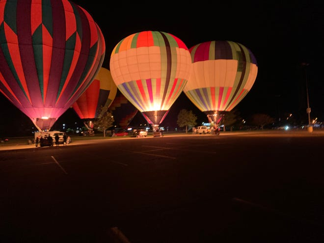 Hot air balloons lit up the night in the parking lot of the New Towne Mall Saturday night in New Philadelphia.