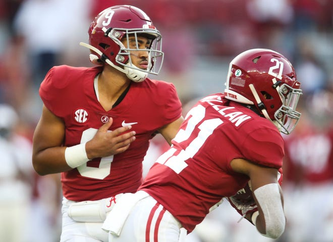 Oct 3, 2020; Tuscaloosa, Alabama, USA; Alabama quarterback Bryce Young (9) hands the ball off to Alabama running back Jase McClellan (21) during the game with Texas A&M at Bryant-Denny Stadium. Alabama defeated A&M 52-24. Mandatory Credit: Gary Cosby Jr/The Tuscaloosa News via USA TODAY Sports