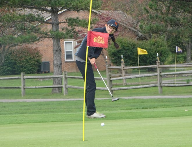 Worthington Christian senior Rena So putts from the fringe on No. 18 during a Division II sectional Sept. 30 at Mill Creek. She shot an 82 to qualify for the district tournament Oct. 5 at Darby Creek.