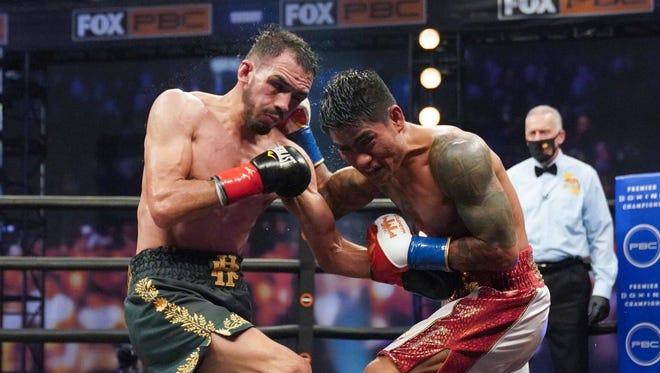 Mark Magsayo, right, scored a split decision victory over Rigoberto Hermosillo, of Victorville, on Saturday night at the Microsoft Theater in Los Angeles.