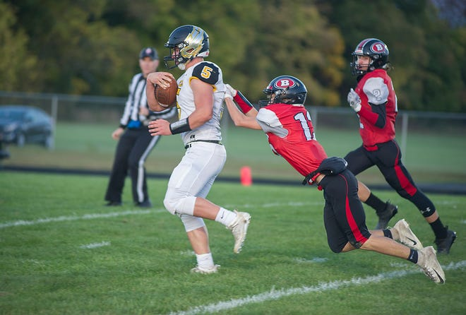 Colonel Crawford's Tristan Cross drags Bucyrus' Braxton Lewis into the red zone.