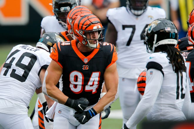 Oct 4, 2020; Cincinnati, Ohio, USA; Cincinnati Bengals defensive end Sam Hubbard (94) makes the stop during the first quarter against the Jacksonville Jaguars at Paul Brown Stadium.
