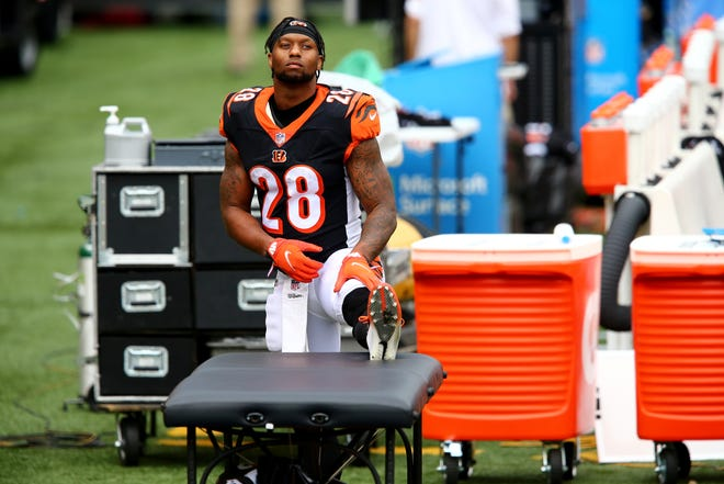 Cincinnati Bengals running back Joe Mixon (28) stretches in the second quarter of a Week 4 NFL football game against the Jacksonville Jaguars, Sunday, Oct. 4, 2020, at Paul Brown Stadium in Cincinnati.