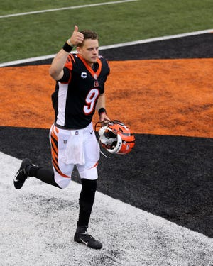Cincinnati Bengals quarterback Joe Burrow (9) gives fans a thumbs up after the 33-25 win against the Jacksonville Jaguars, Sunday, Oct. 4, 2020, at Paul Brown Stadium in Cincinnati.