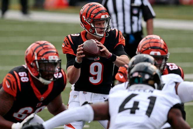 Bengals quarterback Joe Burrow eyes a receiver in Cincinnati's 33-25 win over the Jaguars on Sunday.