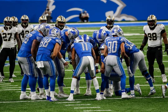 Lions players huddles before a play against the Saints during the first half at Ford Field on Sunday, Oct. 4, 2020.