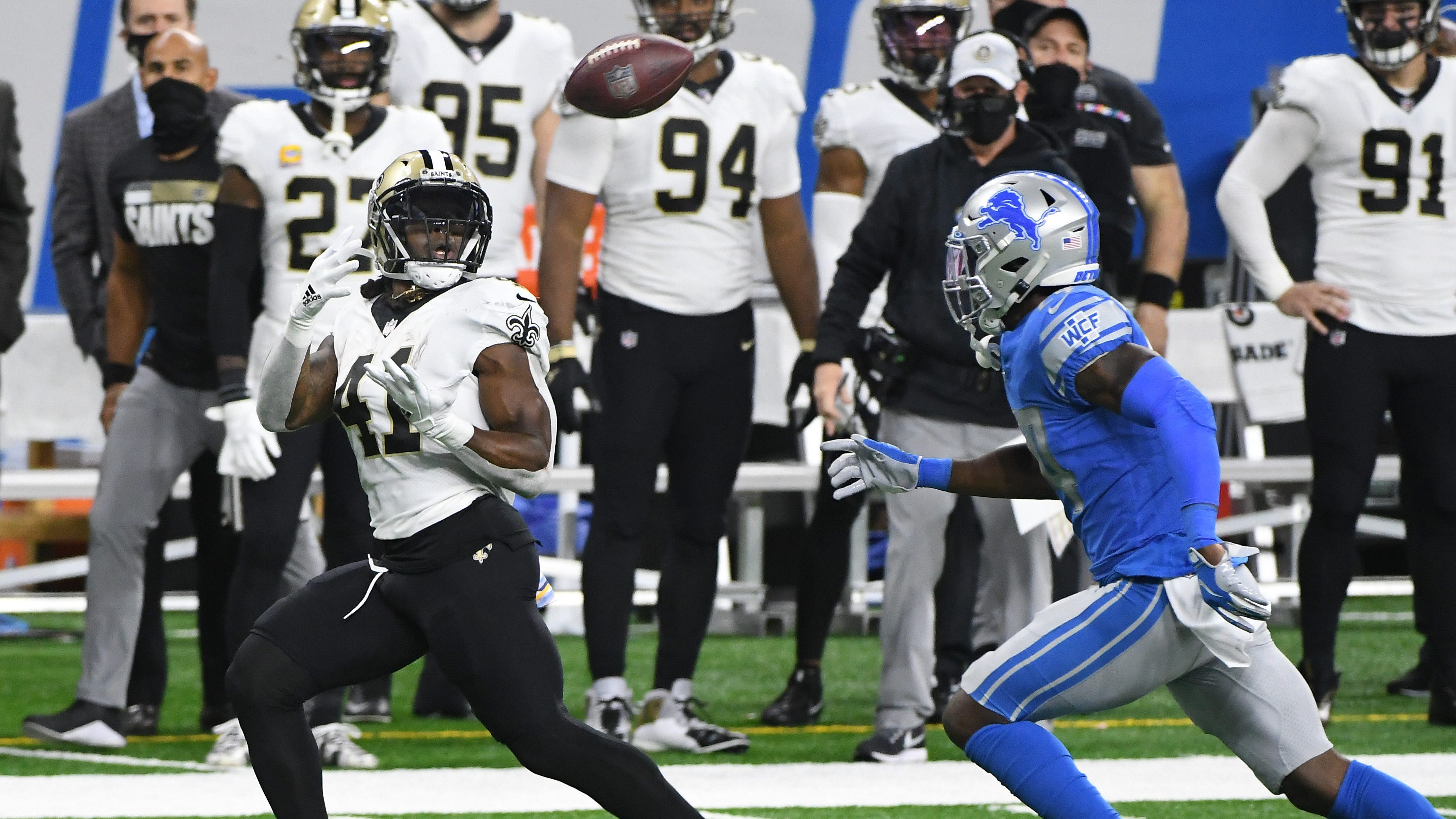 Saints running back Alvin Kamara readies for a long reception in front of Lions safety Will Harris in the second quarter Sunday at Ford Field.