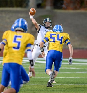 Cascade quarterback James Lewis throws downfield during Saturday's football game at Memorial Stadium.