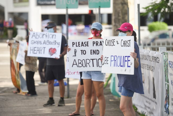 Anti-abortion advocates gather for a peaceful pro-life protest in Tamuning on Oct. 4, 2020.