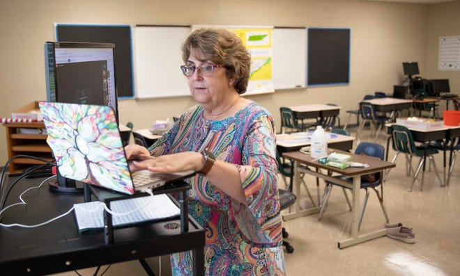 File photo of math teacher Judy Record going through a lesson with her students despite the technical difficulties they had at Rose Hill Middle School in Jackson, Tenn., Thursday, Sept. 3, 2020.