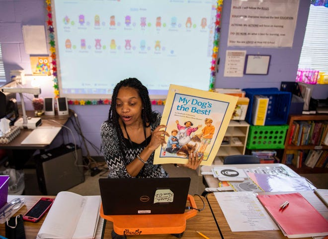 First grade teacher Terreca Bunch introduces a book to her students in the virtual class at Rose Hill Middle School in Jackson, Tenn., Thursday, Sept. 3, 2020. The first week of school, the JMCSS temporarily suspended in-class school due to the rising cases of COVID-19.