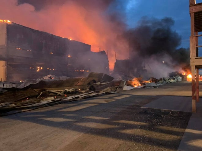 A fire rips through multiple buildings at an egg farm in Palmyra Saturday morning.