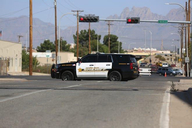 A Dona Ana County sheriff's unit blocks traffic at South Main Street and Union Avenue on Sunday, Oct. 4, 2020.