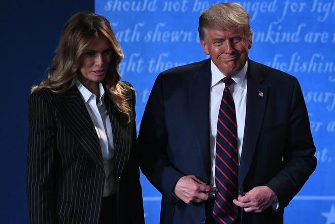 In this file photo, US President Donald Trump and US First Lady Melania Trump leave after the first presidential debate at Case Western Reserve University and Cleveland Clinic in Cleveland, OH, on September 29, 2020. President Trumps's age, sex and weight status increases his risk of developing a severe case of COVID-19. (Saul Loeb/AFP/Getty Images/TNS)