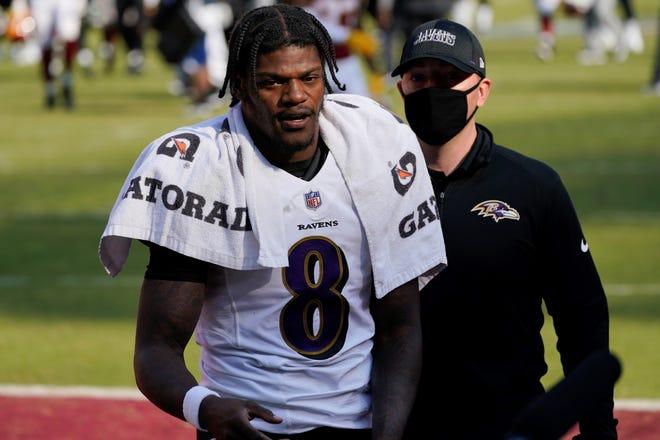 Baltimore Ravens quarterback Lamar Jackson (8) walks off gthe field after an NFL football game against the Washington Football Team, Sunday, Oct. 4, 2020, in Landover, Md. The Baltimore Ravens won 31-17. (AP Photo/Steve Helber)