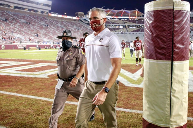 TALLAHASSEE, FL - OCTOBER 3: Head Coach Mike Norvell of the Florida State Seminoles walks off the field after the game vs. the Jacksonville State Gamecocks at Doak Campbell Stadium on Bobby Bowden Field on October 3, 2020 in Tallahassee, Florida. Florida State defeated Jacksonville State 41 to 24.