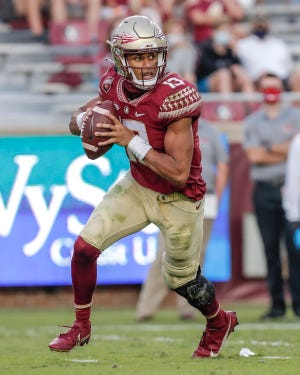 Florida State quarterback Jordan Travis (13) scrambles on a passing play during the game against the Jacksonville State Gamecocks at Doak Campbell Stadium on Bobby Bowden Field on Saturday in Tallahassee. Florida State defeated Jacksonville State 41-24.