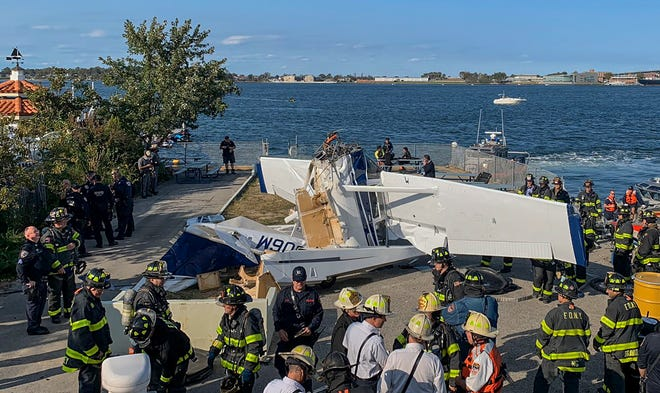 This photo provided by the Fire Department of New York shows the wreckage of a single-engine Cessna seaplane after it crashed into a New York City pier on Sunday.