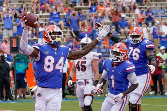 Florida tight end Kyle Pitts celebrates a 4-yard touchdown catch against South Carolina.