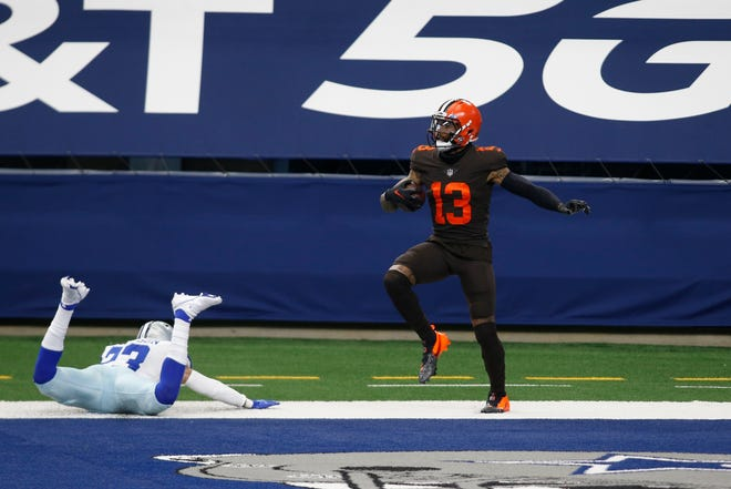 Browns wide receiver Odell Beckham Jr. catches a touchdown pass against Dallas Cowboys strong safety Darian Thompson in Sunday's game.