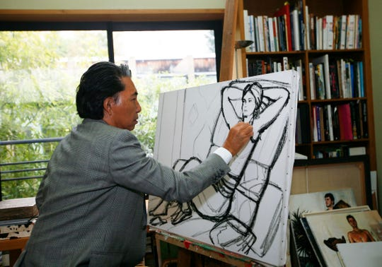 In this Tuesday, March 24, 2009 file photo, Japanese fashion designer Kenzo Takada sketches in his Paris house.