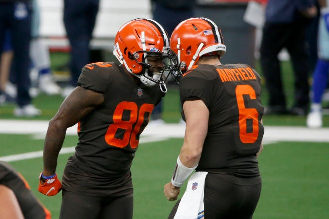 Cleveland Browns wide receiver Jarvis Landry (80) and quarterback Baker Mayfield (6) celebrate after Landry threw a touchdown pass to wide receiver Odell Beckham Jr. in the first half of an NFL football game against the Dallas Cowboys in Arlington, Texas, Sunday, Oct. 4, 2020.