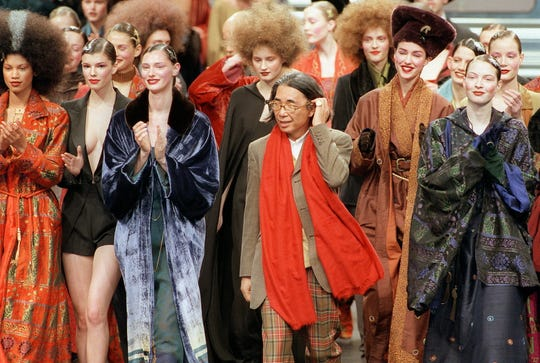 In this file photo taken on March 13, 1998 Japanese fashion designer Kenzo (C) salutes the audience at the end of his's ready-to-wear Fall/Winter 1998/99 collection presentation in Paris.