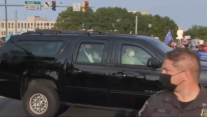 Donald Trump Drives By Supporters Outside Walter Reed