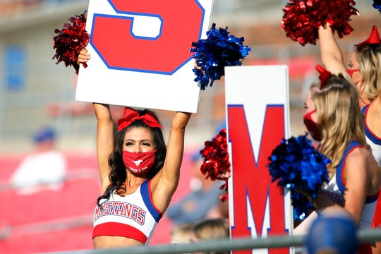 Southern Methodist cheerleaders perform in the stands during the game against the Memphis Tigers at Gerald J. Ford Stadium.