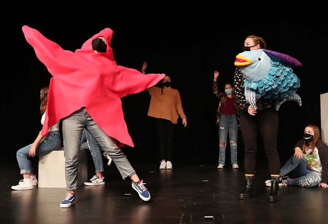"""Brianna Becerra, left, dances around as the Starfish as Jessica Reber portrays Rainbow Fish during rehearsal of the children's play """"The Rainbow Fish"""" at Wadsworth High School Oct. 1."""