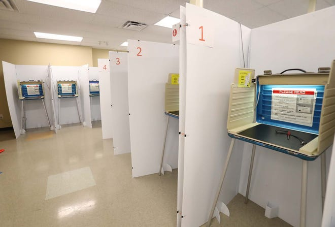 For those voting early in person, large partitions have been placed between voting booths at the early voting center in Summit County.