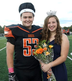 Walter Bungard, left, was crowned Marlington's 2020 Duke, and Lexi Sabatino, right, was crowned 2020 Duchess before the start of the Marlington-Minerva football game Friday at Duke Stadium.