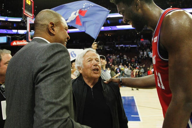 Doc River, left, and the Sixers' Joel Embiid share a laugh with Patriots CEO Robert Kraft.