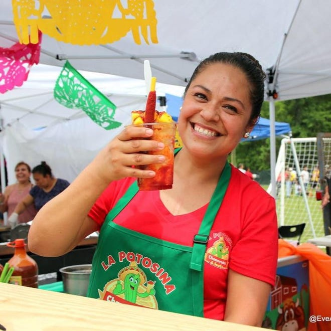 Nadia Paez, owner of La Potosina in Ridgeland, displays a chamoyada mango, an ice smoothie with mangoes, during a past event. It will be featured at this year's Latin Heritage Festival in Ridgeland.