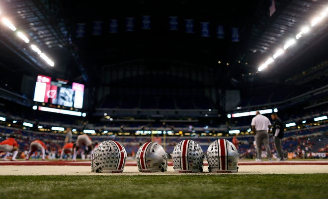Ohio State Buckeyes quarterback helmets sit on the ground before their game against Wisconsin Badgers during the Big Ten Championship game at the Lucas Oil Stadium in Indianapolis, Ind on December 2, 2017.  [Kyle Robertson/Dispatch]