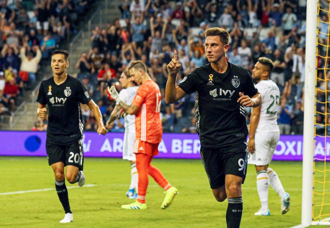 Sporting Kansas City forward Krisztian Nemeth (9) celebrates after scoring against the Portland Timbers during the first half at Children's Mercy Park in Kansas City, Kan., on Sept. 29, 2020.