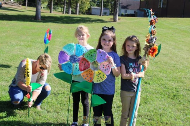 Flower art sculptures were installed at Creekside Park for display during October.