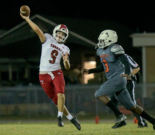 Tavares quarterback Lock McDonald (9) throws under pressure during Friday's game against Leesburg at H.O. Dabney Stadium in Leesburg. [PAUL RYAN / CORRESPONDENT]