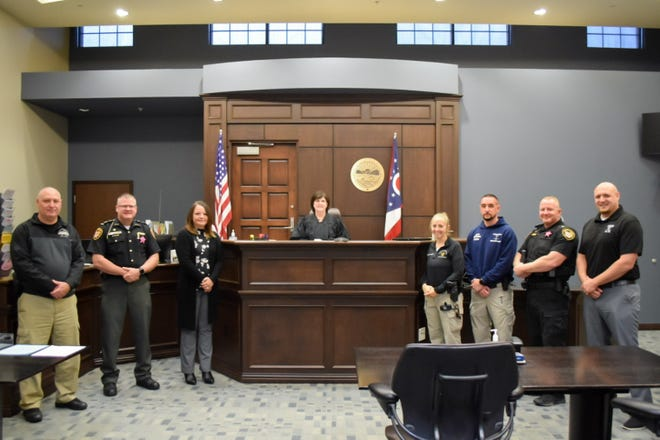 Members of the Marcy's Law task force stand with Magistrate Teresa Liston at the Cambridge Municipal building. Pictured left to right: Lt. Jim Stoney, Sheriff Jeffrey D. Paden, Michelle Carpenter-Wilkinson, Magistrate Teresa Liston, Zandrea Wolfe, Seth Cowgill, Major Jeremy Wilkinson, and Taylor Leppla.