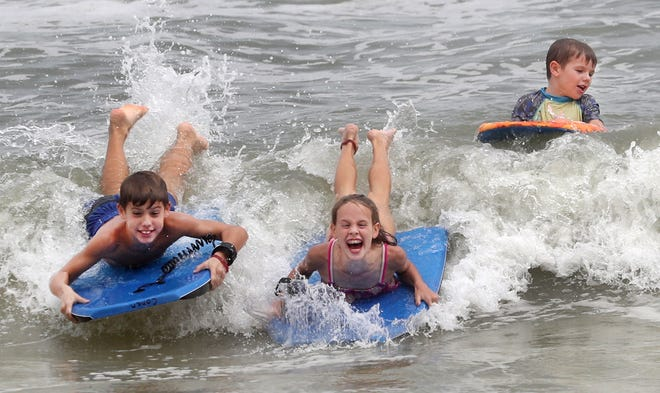 Kids catch some waves in front of the Bandshell in Daytona Beach on  Monday, Oct. 5, 2020. September was a rainy month and forecasters predict more of the same for October.